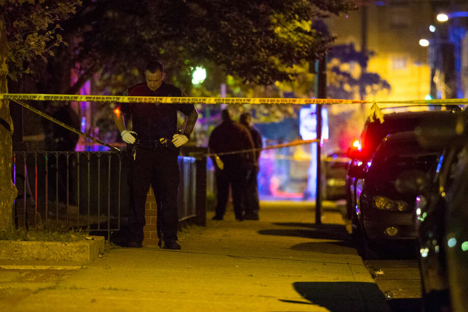 Hour photo/Chris Palermo.Norwalk Police investigate a reported shooting at the Washington Village Housing Complex on Water Street Thursday night.