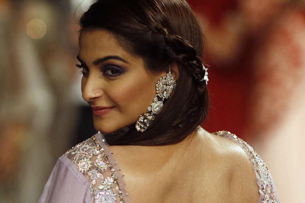 Indian Bollywood actress Sonam Kapoor displays creations at the grand finale of India International Jewelry Week in Mumbai, India, Thursday, Aug. 6, 2015. (AP Photo/Rajanish Kakade)