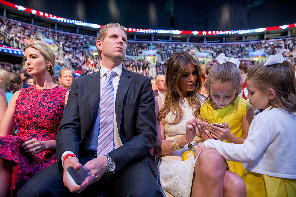The daughters of Republican presidential candidate Sen. Ted Cruz, R-Texas, Catherine, 4, right, and Caroline, 7, center, visit with Donald Trump's wife Melania Trump, third from right, accompanied by Donald Trump's children Ivanka Trump, left, and Eric Trump, second from left, during a commercial break in the first Republican presidential debate at the Quicken Loans Arena, Thursday, Aug. 6, 2015, in Cleveland. (AP Photo/Andrew Harnik)