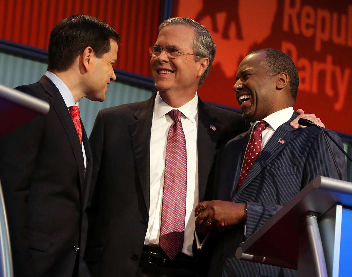 Republican presidential candidates from left, Marco Rubio, Jeb Bush and Ben Carson talk during a break during the first Republican presidential debate at the Quicken Loans Arena Thursday, Aug. 6, 2015, in Cleveland. (AP Photo/Andrew Harnik)