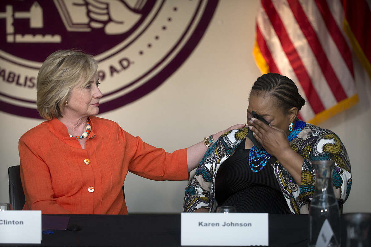 Democratic presidential candidate Hillary Rodham Clinton, left, comforts home care consumer Karen Johnson who became emotional while sharing her story during a roundtable discussion home care, Thursday, Aug. 6, 2015, in Los Angeles. (AP Photo/Jae C. Hong)