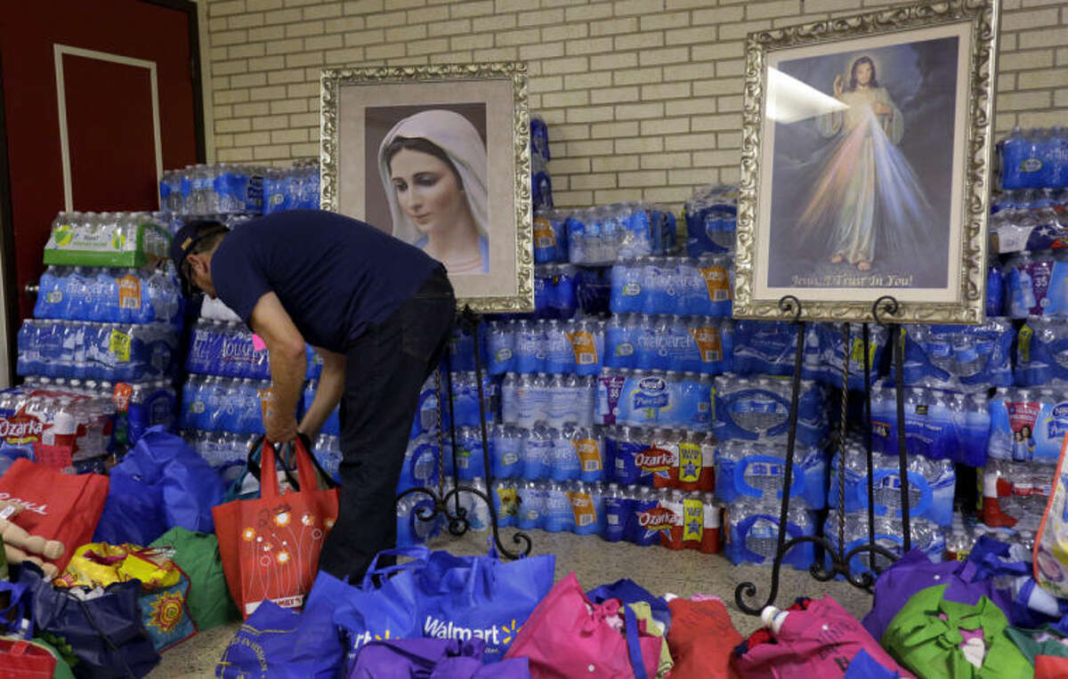 In this June 20, 2014 photo, donated items for immigrant families who have crossed the U.S.-Mexico border illegally are arranged at the Sacred Heart Catholic Church in McAllen, Texas. Just since October, the Border Patrol?'s Rio Grande Valley sector has made more than 194,000 arrests, nearly triple that of any other sector. Most are from Central America, and many are children. (AP Photo/Eric Gay)