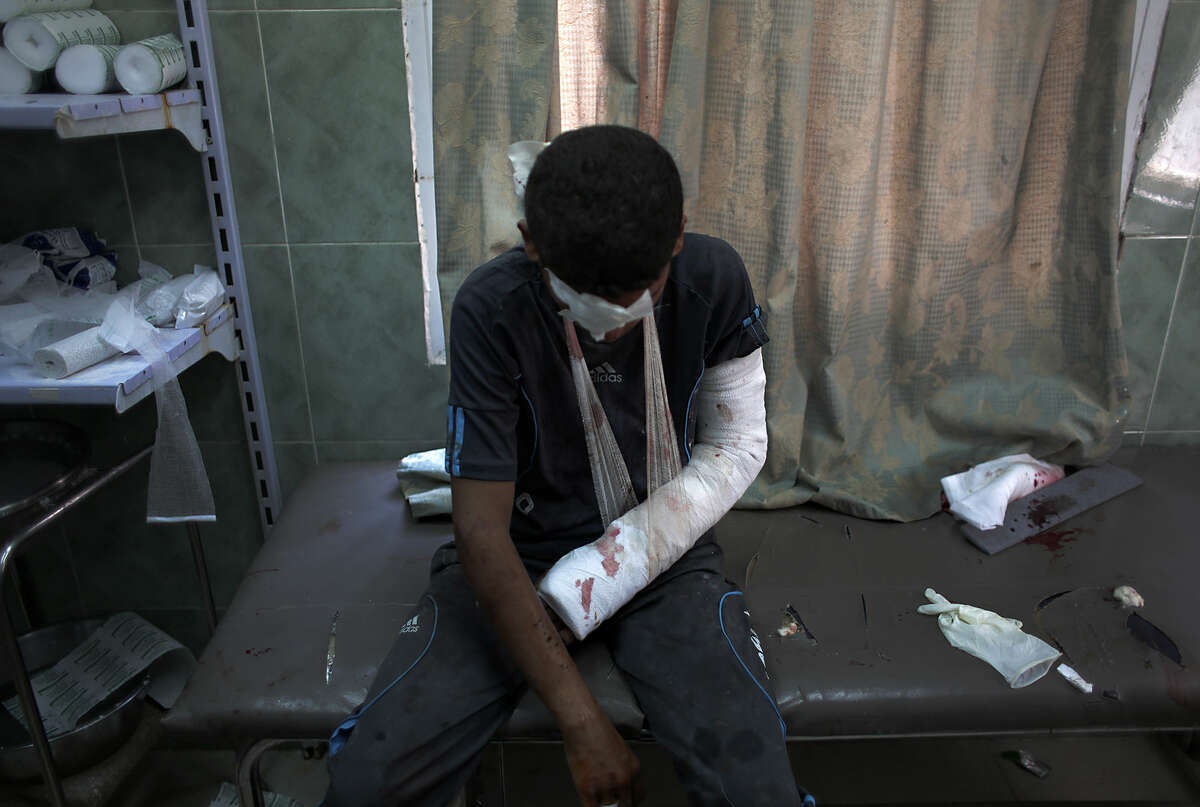 An injured Palestinian boy rests after receiving treatment for his injuries at the Najjar hospital in Rafah, southern Gaza Strip, Thursday, Aug. 6, 2015. Palestinian health official said at least four Palestinians from the same family were killed and 13 people were injured in the Gaza Strip on Thursday by an explosion of Israeli military ordnance left over from last summer's war. (AP Photo/ Khalil Hamra)