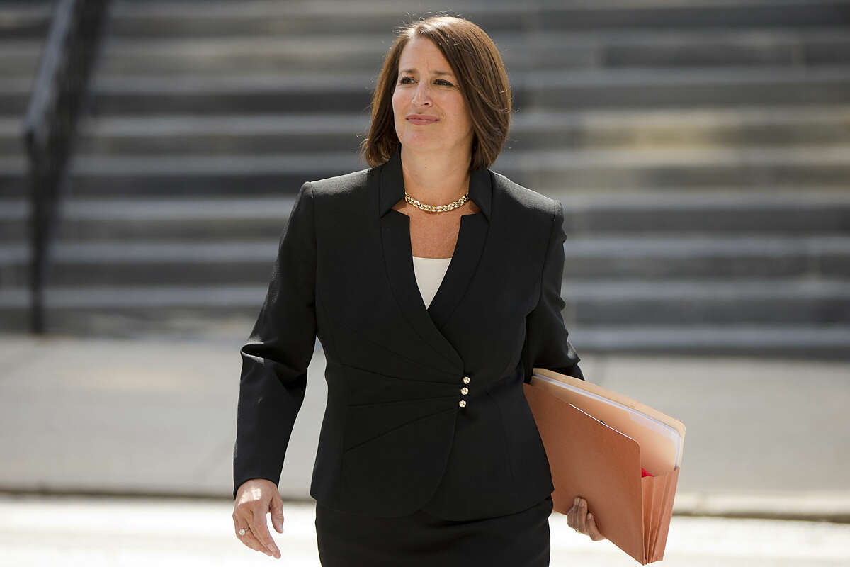 Montgomery County District Attorney Risa Vetri Ferman walks to a news conference, Thursday, Aug. 6, 2015, in Norristown, Pa. Ferman announced charges against Attorney General Kathleen Kane, of leaking secret grand jury information and lying about her actions under oath. (AP Photo/Matt Rourke)