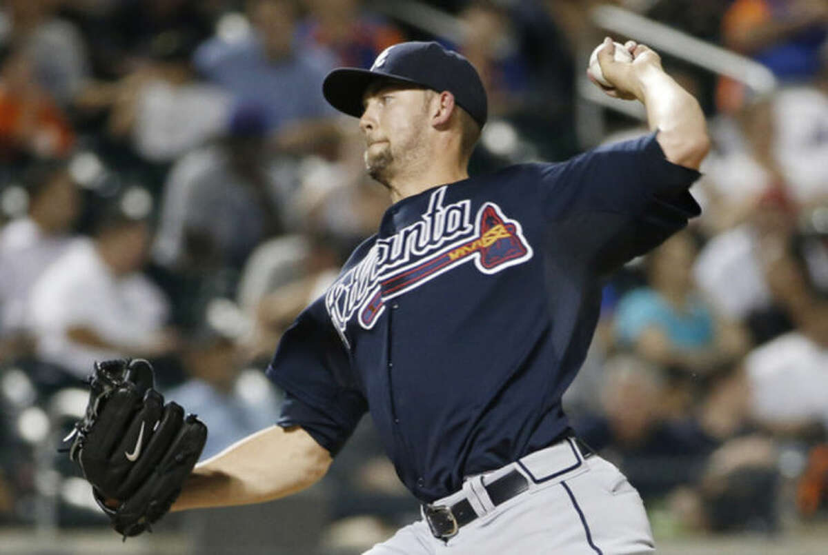 Atlanta Braves starting pitcher Mike Minor (36) delivers in the sixth inning of in a baseball game against the New York Mets in New York, Monday, July 7, 2014. (AP Photo/Kathy Willens)