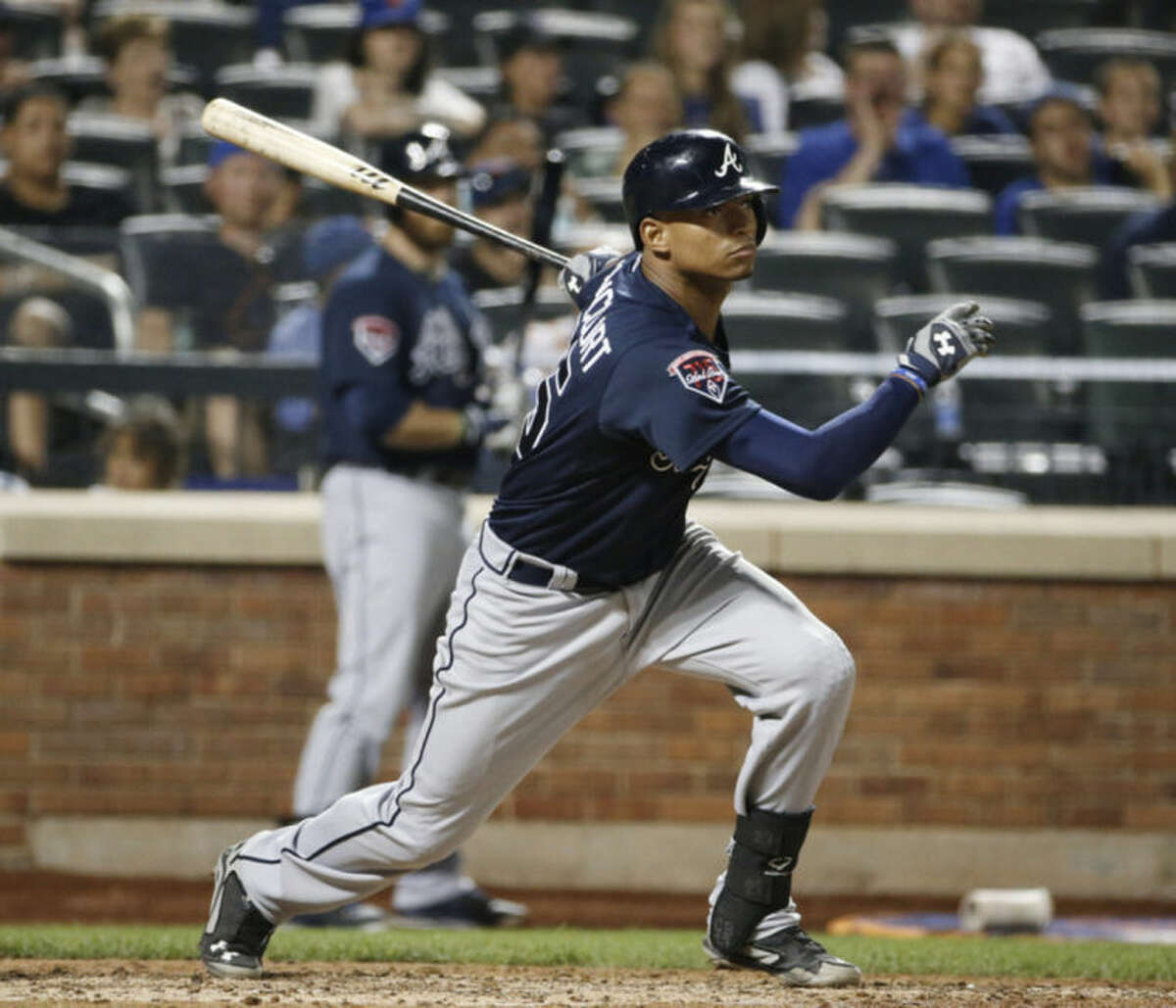Atlanta Braves catcher Christian Bethancourt hits an eighth-inning RBI single that scored the Braves Chris Johson in a baseball game in New York, Monday, July 7, 2014. (AP Photo/Kathy Willens)