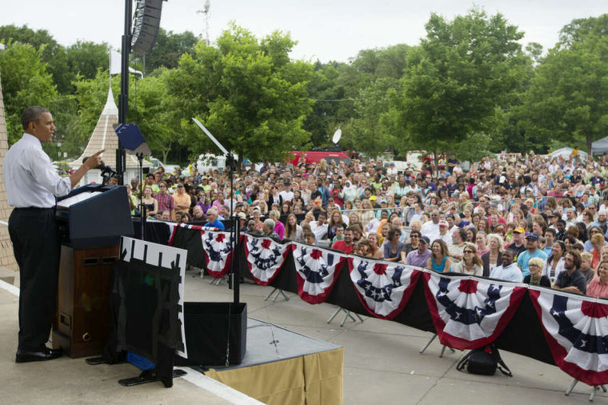 FILE - In this June 27, 2014, file photo, President Barack Obama speaks about the economy at Lake Harriet Band Shell in Minneapolis, Minn. ?