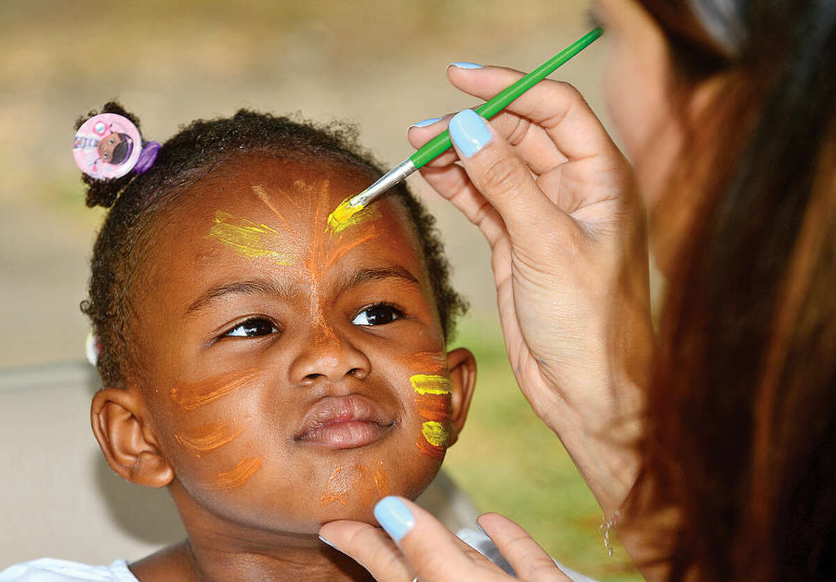 Hour photo / Erik Trautmann Natlaie Armah, 4, gets her face painted during the annual Sono Day Out at Ryan Park in South Norwalk Saturday.