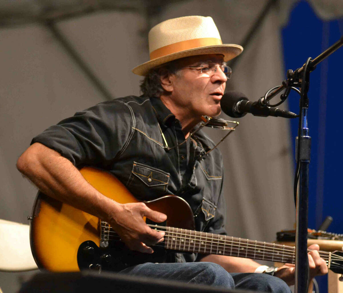 Photo by Mike Horyzun Ray Bonneville sings and plays guitar during the Falcon Ridge Folk Festival in Hilldale, NY last weekend.