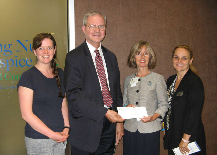 Elona Needle (far right) and David Van Buskirk of First County Bank present a check to Visiting Nurse & Hospice of Fairfield County's Development Coordinator, Aislinn Gavin (at left) and Agency President and CEO, Sharon Bradley, in support of the Agency's Community Health Program.