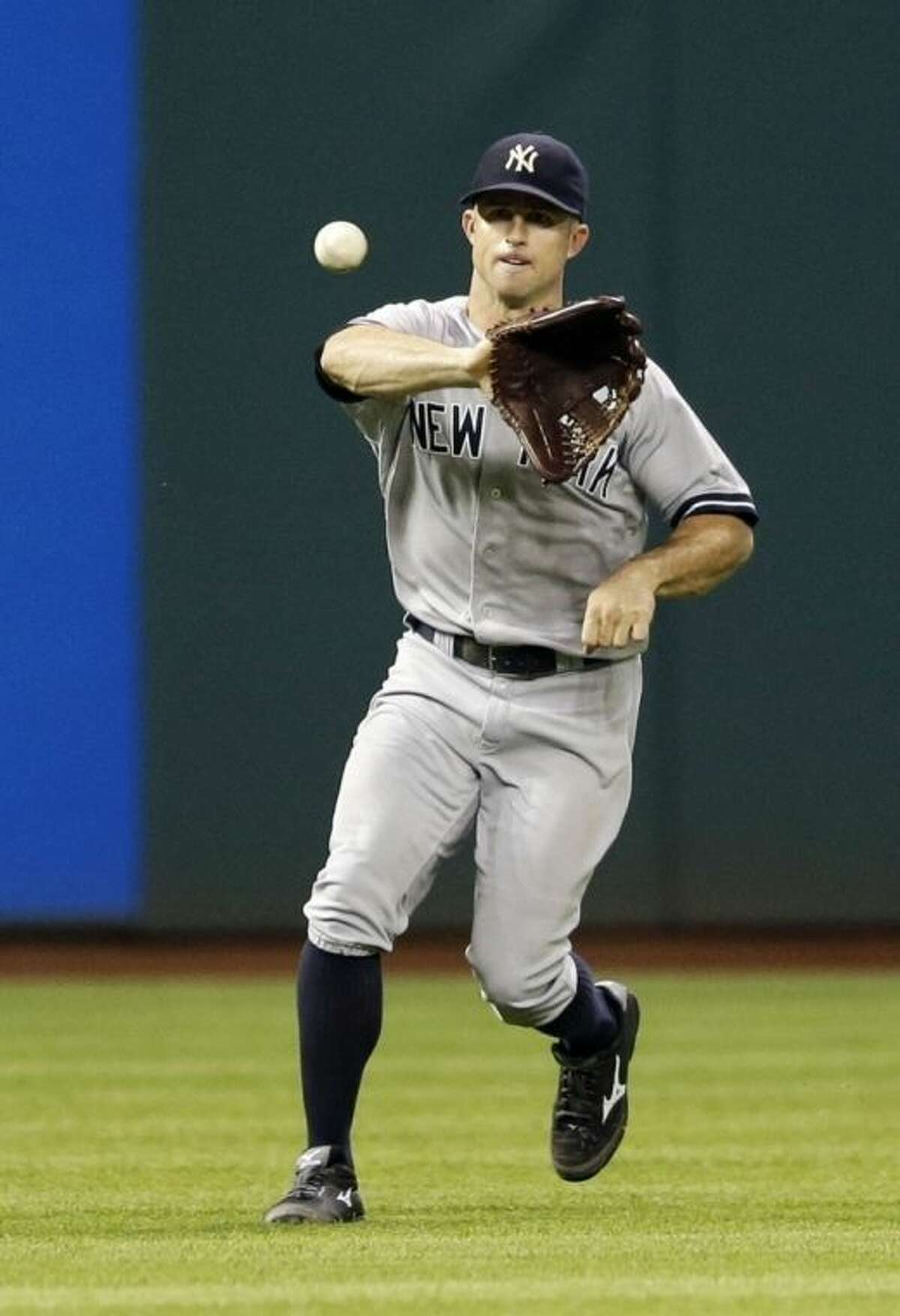 New York Yankees' Brett Gardner fields an RBI single hit by Cleveland Indians' Asdrubal Cabrera in the sixth inning of a baseball game, Monday, July 7, 2014, in Cleveland. Chris Dickerson scored on the play. (AP Photo/Tony Dejak)
