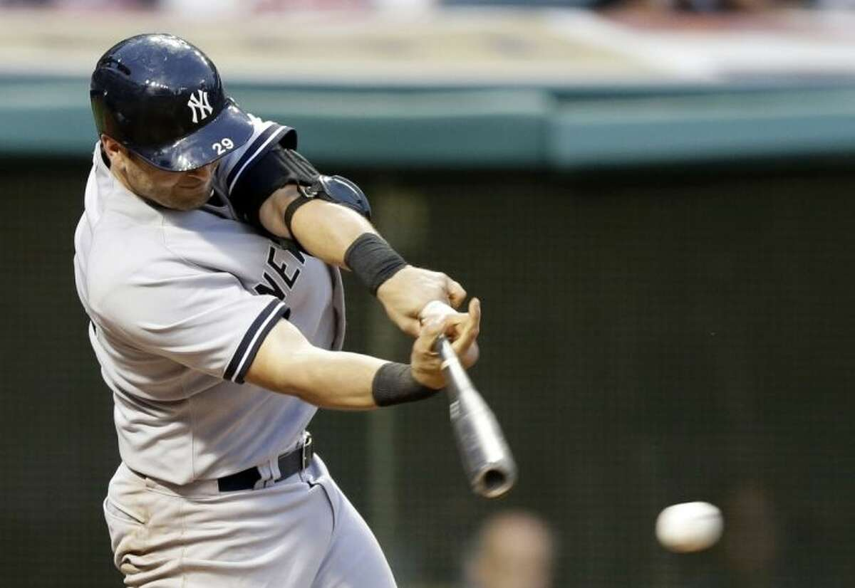 New York Yankees' Francisco Cervelli hits off Cleveland Indians relief pitcher Kyle Crockett in the third inning of a baseball game, Monday, July 7, 2014, in Cleveland. Cervelli was safe at first on a fielder's choice. Brian McCann scored on the play. (AP Photo/Tony Dejak)
