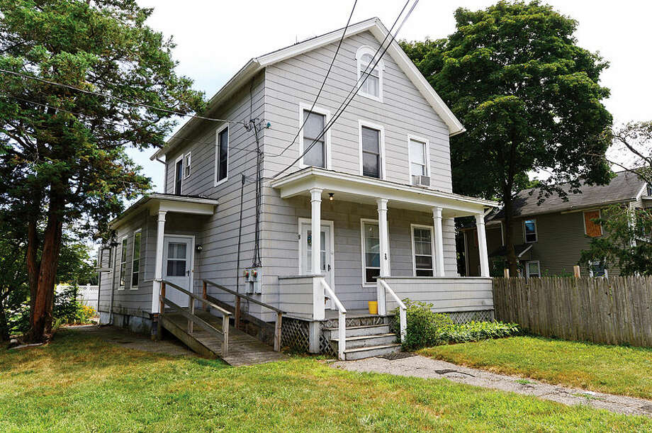 Hour photo/Erik TrautmannThe home at 20 Plymouth Ave. that was struck by gunfire during a early morning shots fired incident Saturday.