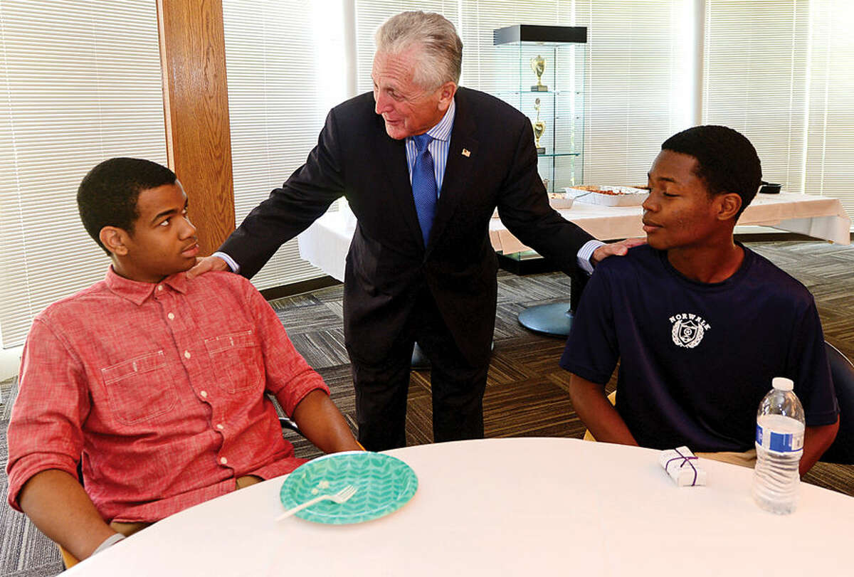 Hour photo / Erik Trautmann Mayor Harry Rilling thanks participants Dakari Smith and Dolny Desrogene as the Norwalk Community College hosts a luncheon Friday to honor those area high school students in the Mayor's Summer Youth Program at Norwalk Community College.
