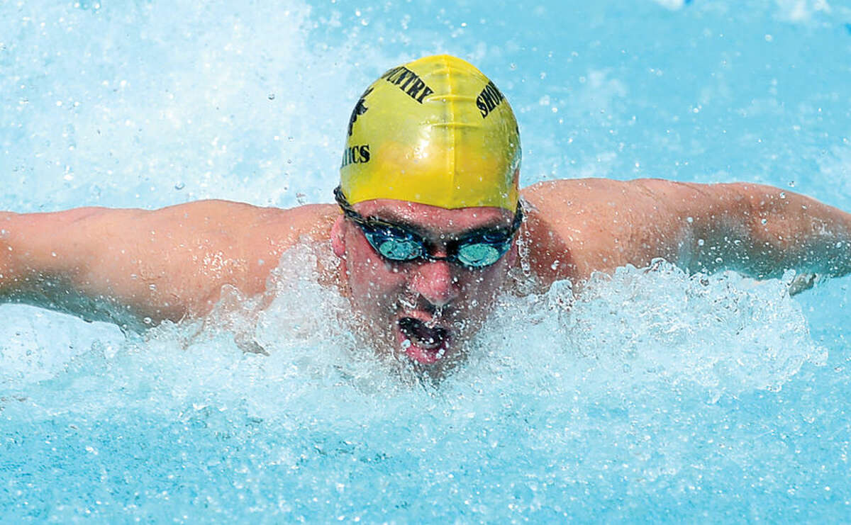 Hour photo / Erik Trautmann Shore and Country Club's Eddie Donavan swims in the 17 and under 100M IM during the Fairfield County Swim League Championship meet at Roxbury Country Club in Stamford Saturday.