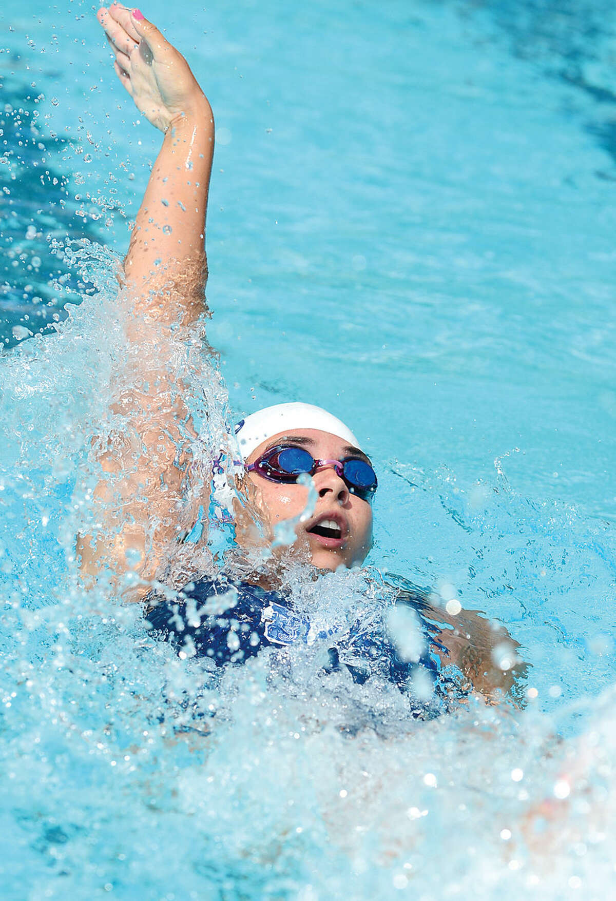 Hour photo / Erik Trautmann Shore and Country Club's Shannon Buttling swims in the 17 and under 100M IM during the Fairfield County Swim League Championship meet at Roxbury Country Club in Stamford Saturday.