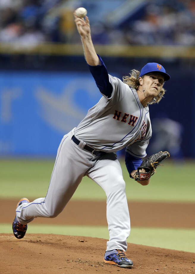 New York Mets starting pitcher Noah Syndergaard delivers to the Tampa Bay Rays during the first inning of a baseball game Saturday, Aug. 8, 2015, in St. Petersburg, Fla. (AP Photo/Chris O'Meara)