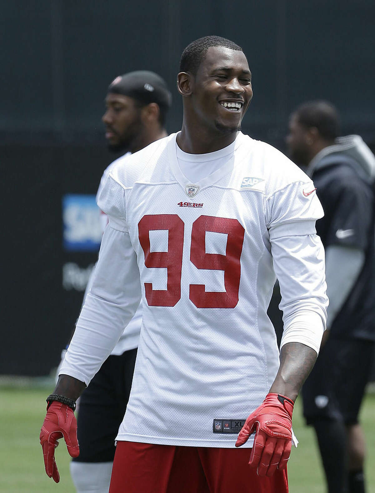 FILE - In this May 29, 2015 file photo, San Francisco 49ers linebacker Aldon Smith (99) smiles during practice at an NFL football facility in Santa Clara, Calif. Police in Northern California have arrested and accused Smith of hit and run, drunken driving and vandalism on Thursday, Aug. 6, 2015. (AP Photo/Jeff Chiu, File)