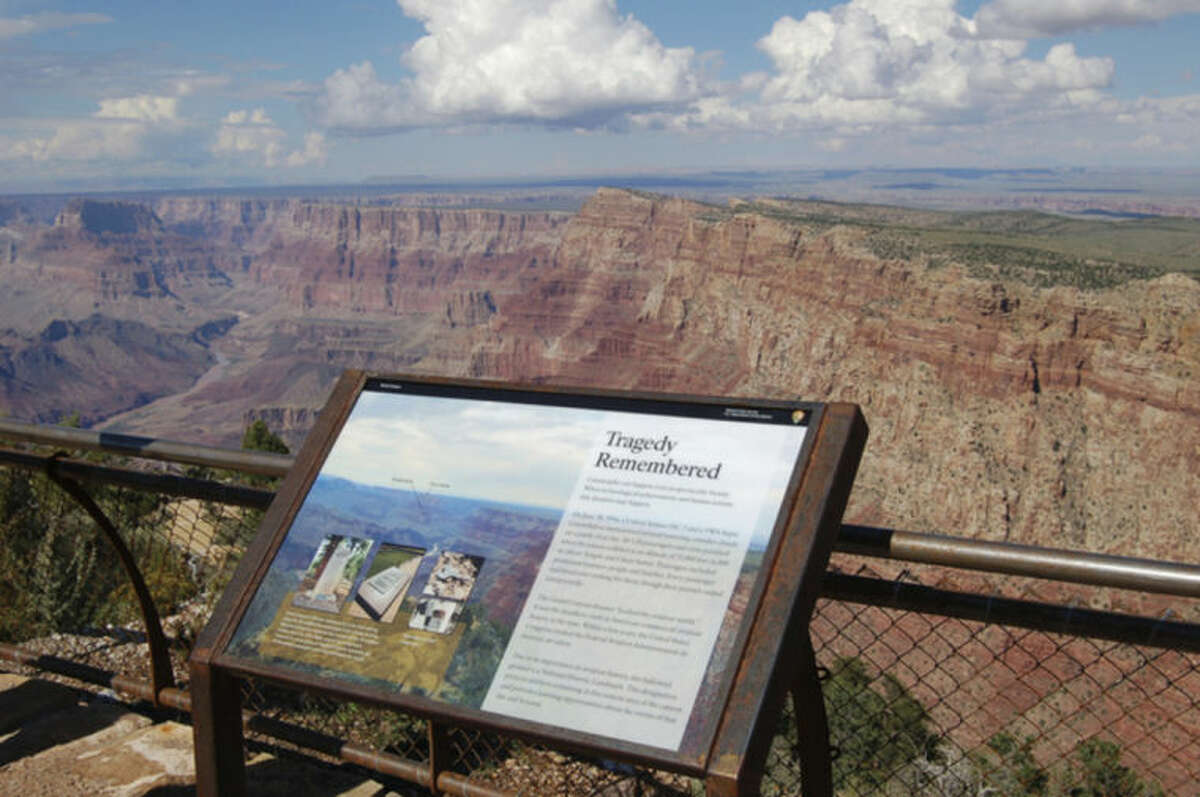 In this Sept. 12, 2013 photo released by the Grand Canyon National Park Service, shows a National Historical Landmark plate overlooking the east end of the Grand Canyon, Ariz. Two commercial airplanes, United Flight 718 and TWA Flight 2 crashed on June 30, 1956 over the Grand Canyon, killing all 128 people aboard in one of the deadliest aviation disasters in the U.S. On Tuesday, July 8, 2014, the Grand Canyon National Park will mark the designation of the crash site as a National Historic Landmark in a ceremony overlooking the gorge where the wreckage was scattered over 1.5 square miles. (AP Photo/Grand Canyon National Park Service)