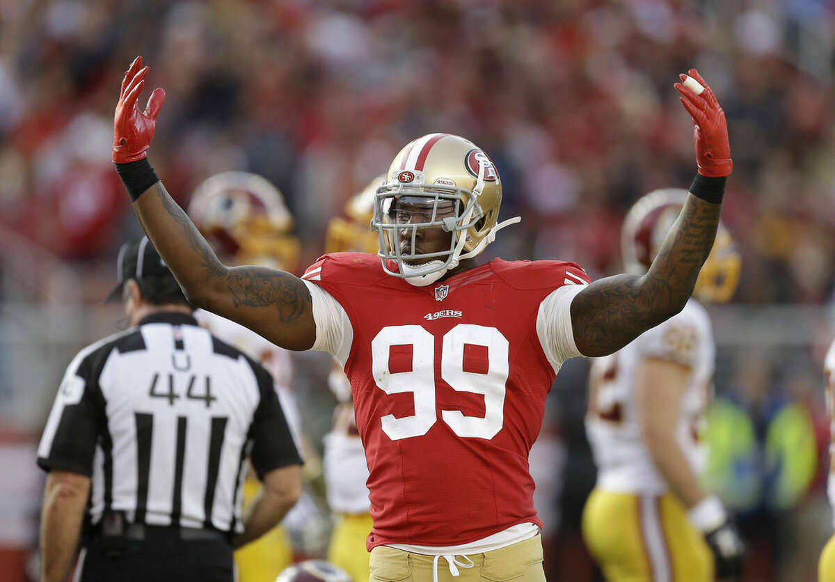 FILE - In this Nov. 23, 2014, file photo, San Francisco 49ers linebacker Aldon Smith gestures against the Washington Redskins during an NFL football game in Santa Clara, Calif. Smith received second chance after second chance with the 49ers, who parted ways with their troubled linebacker Friday, Aug. 7, 2015, following his fifth run-in with the law. Santa Clara police arrested Smith on Thursday, and accused him of drunken driving, hit and run and vandalism. (AP Photo/Ben Margot, File)