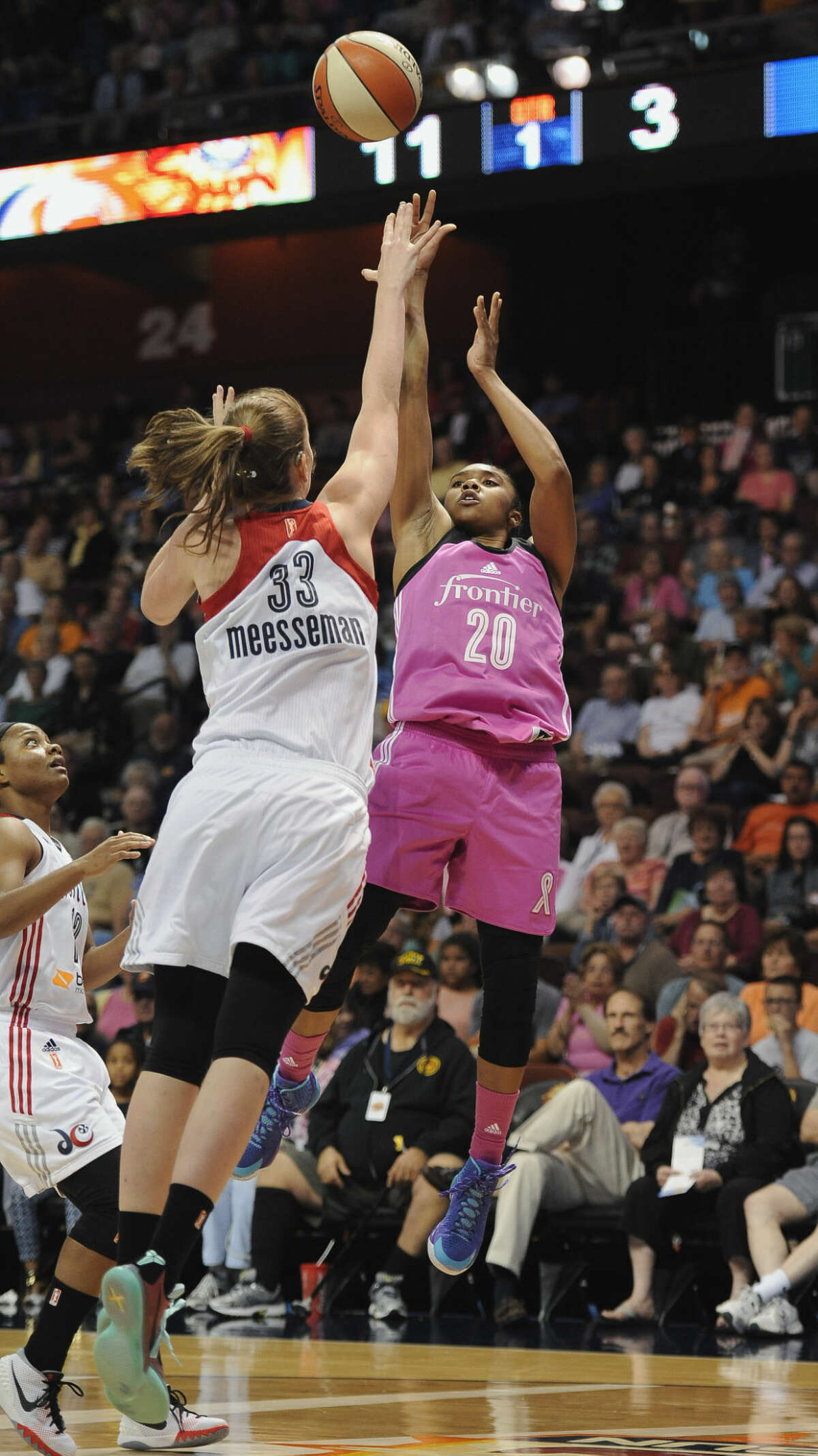 Connecticut Sun's Alex Bentley, right, shoots over Washington Mystics' Emma Meesseman during the first half of a WNBA basketball game, Friday, Aug. 7, 2015, in Uncasville, Conn. (AP Photo/Jessica Hill)