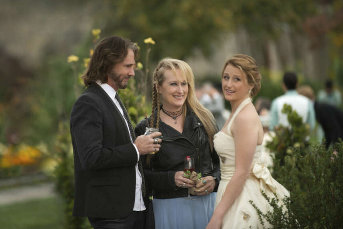 This photo provided by courtesy of Sony Pictures shows, Rick Springfield, from left, as Greg, Meryl Streep, as Ricki, and Mamie Gummer as Julie, in TriStar Pictures'