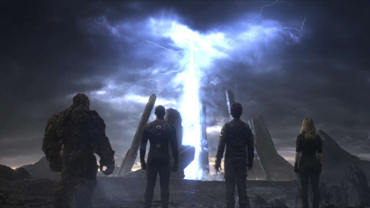 This photo provided by courtesy Twentieth Century Fox shows, The Thing, from left, Michael B. Jordan as Johnny Storm, Miles Teller as Dr. Reed Richards, and Kate Mara as Sue Storm, in a scene from the film,