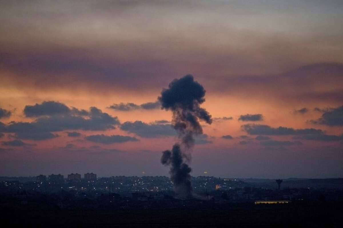Smoke rises following an Israeli strike on Gaza, as seen from the Israel-Gaza Border, Tuesday, July 8, 2014. The Israeli military launched a major offensive in the Hamas-ruled Gaza Strip on Tuesday, striking more than 100 sites and mobilizing troops for a possible ground invasion in what Israel says is an operation aimed at stopping a heavy barrage of rocket attacks from the Palestinian territory.(AP Photo/Ariel Schalit)