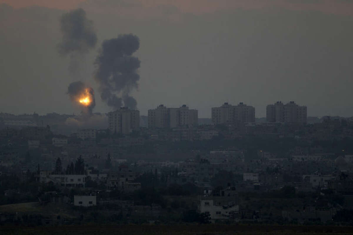 Israeli strikes on Gaza are seen from the Israel-Gaza Border, Tuesday, July 8, 2014. The Israeli military launched a major offensive in the Hamas-ruled Gaza Strip on Tuesday, striking more than 100 sites and mobilizing troops for a possible ground invasion in what Israel says is an operation aimed at stopping a heavy barrage of rocket attacks from the Palestinian territory.(AP Photo/Ariel Schalit))