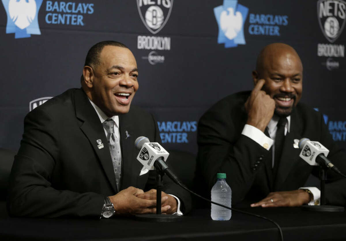 While Brooklyn Nets general manager Billy King, right, listens, Lionel Hollins speaks to the media during a news conference at the Barclays Center in New York, Monday, July 7, 2014. Hollins was introduced as the new head coach of the Brooklyn Nets. (AP Photo/Seth Wenig)