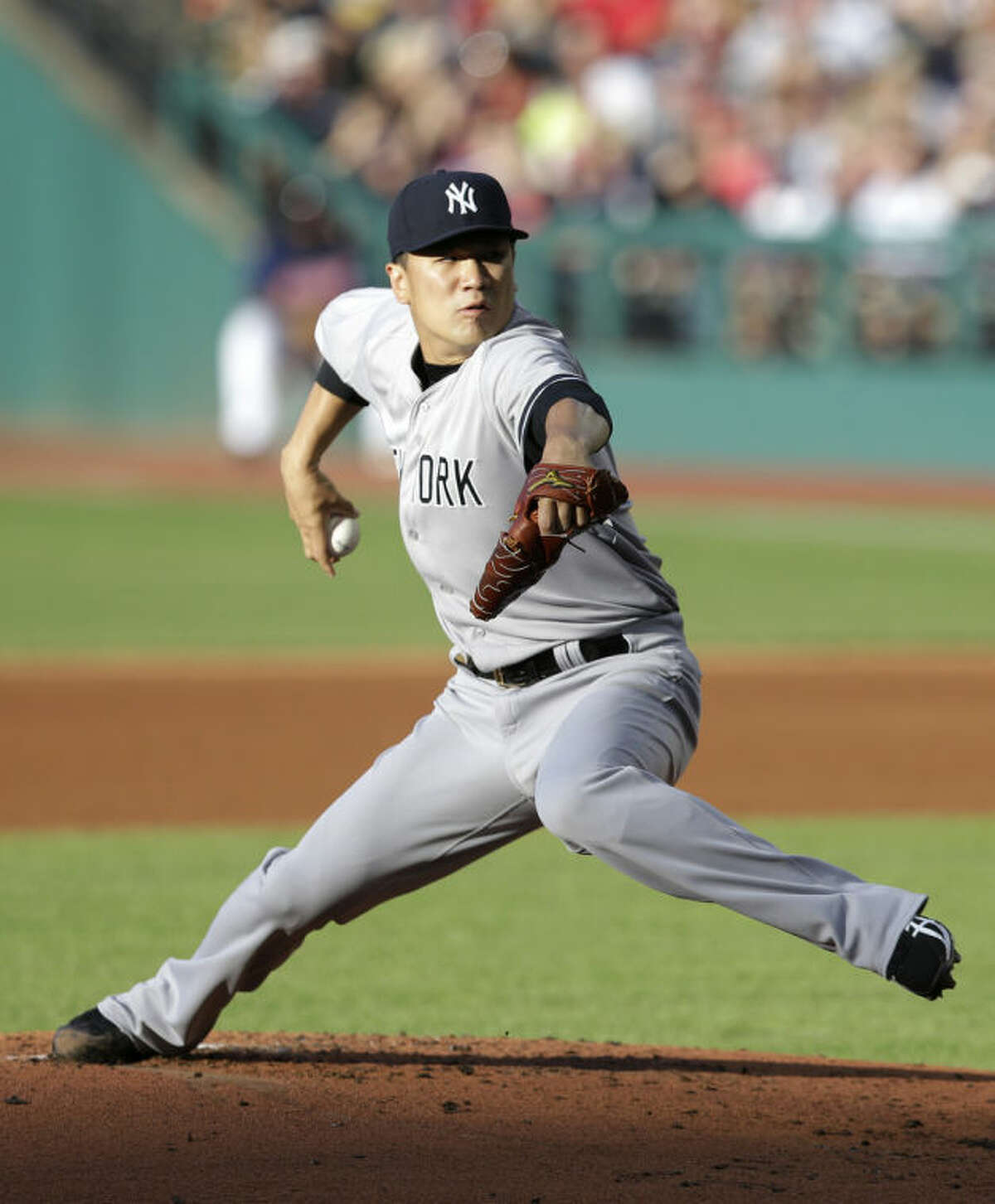 New York Yankees starting pitcher Masahiro Tanaka delivers in the first inning of a baseball game against the Cleveland Indians, Tuesday, July 8, 2014, in Cleveland. (AP Photo/Tony Dejak)