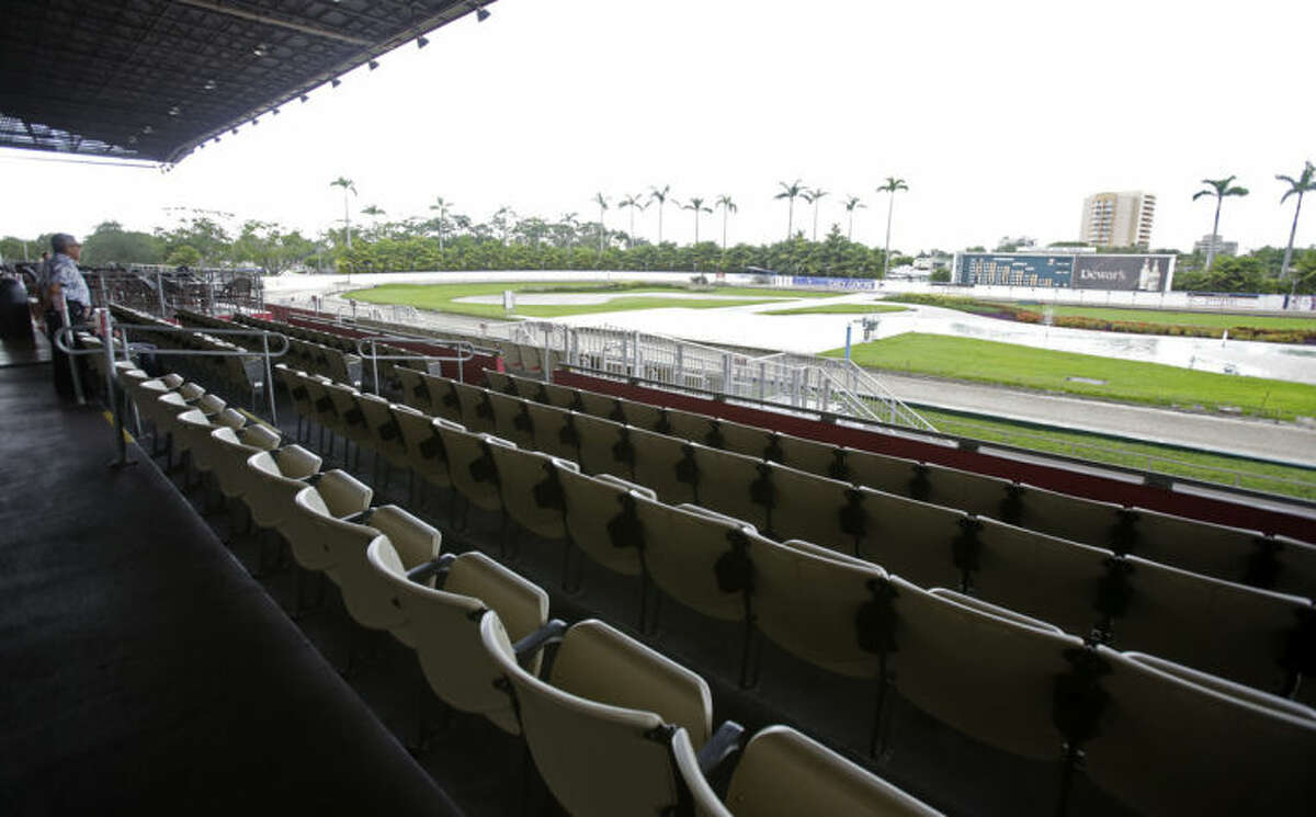 In this photo taken Tuesday, July 8, 2014, is a view of the stands on a race day at Flagler Dog Track in Miami. The dog racing business, at once doomed and propped up by casino gambling, has come to a crossroads. (AP Photo/Alan Diaz)