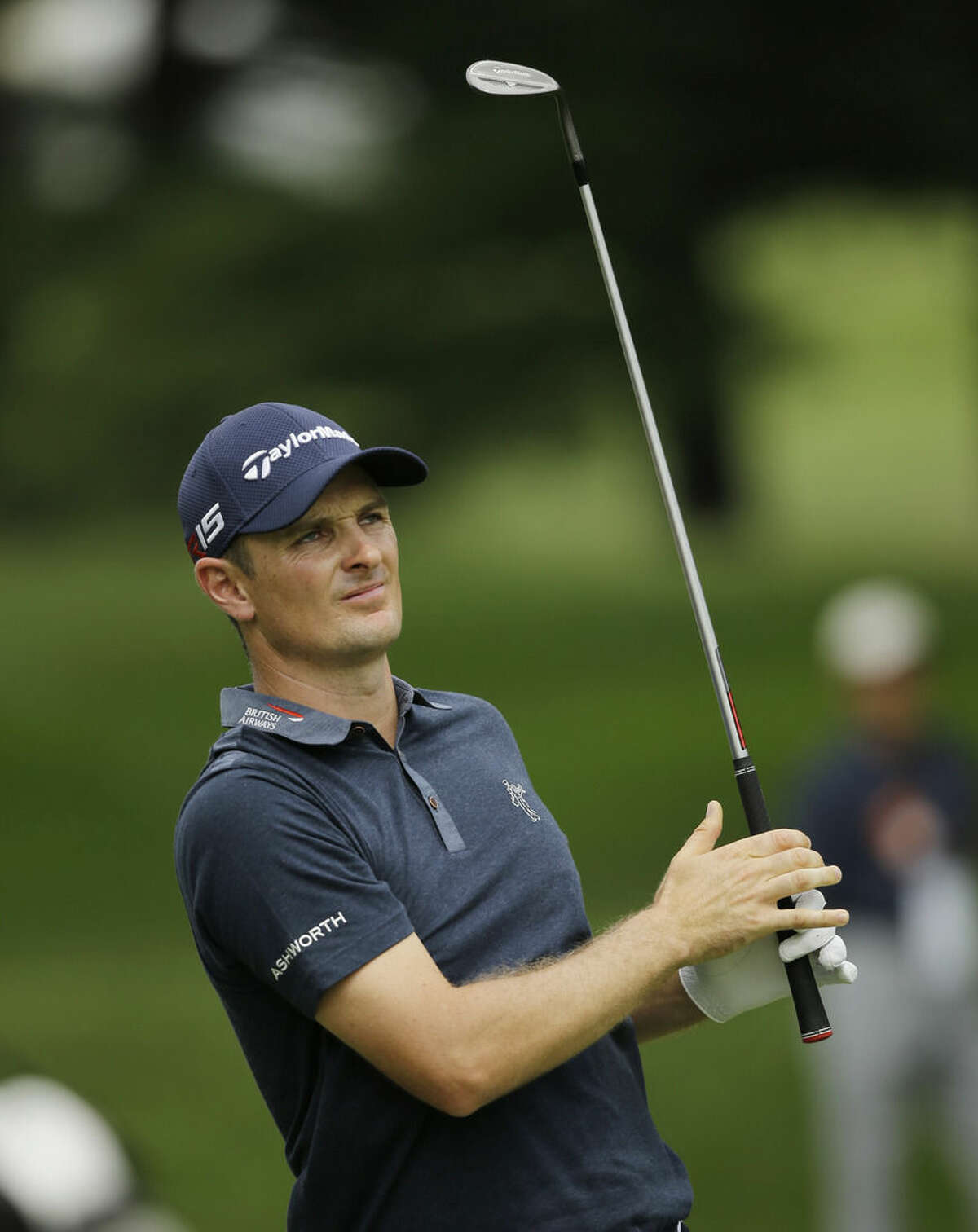 Justin Rose, from England, hits from the fairway on the first hole during the final round of the Bridgestone Invitational golf tournament at Firestone Country Club, Sunday, Aug. 9, 2015, in Akron, Ohio. (AP Photo/Tony Dejak)