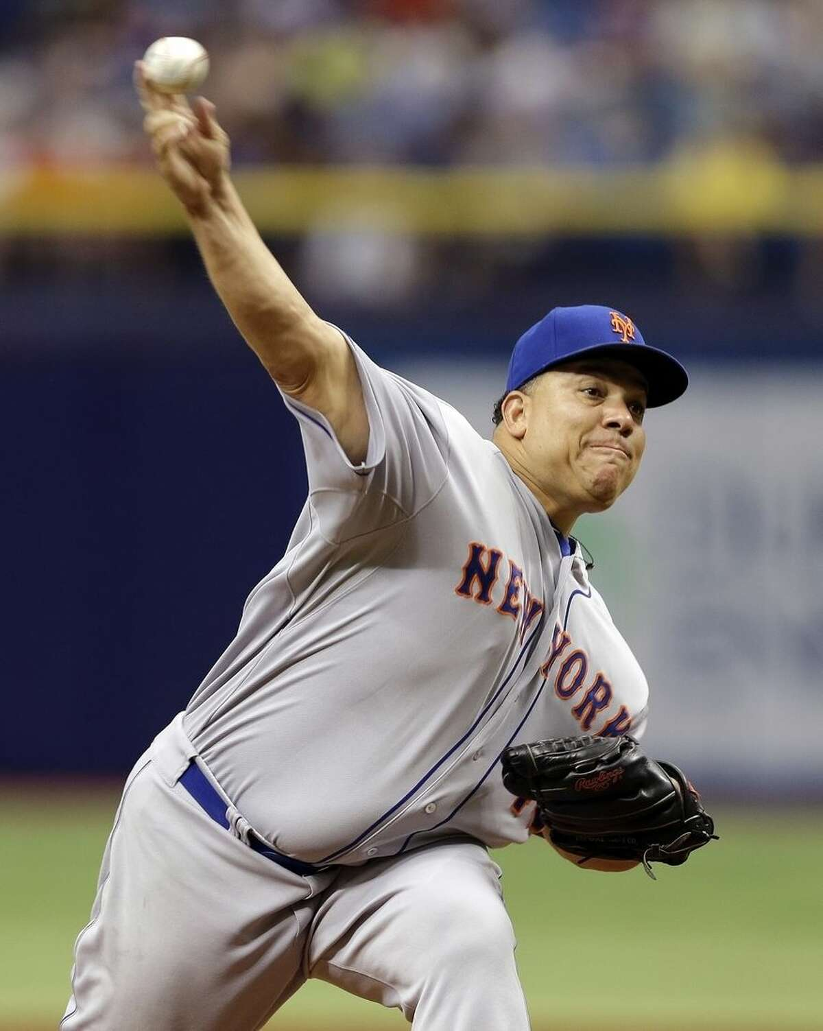 New York Mets starting pitcher Bartolo Colon delivers to the Tampa Bay Rays during the first inning of an interleague baseball game Sunday, Aug. 9, 2015, in St. Petersburg, Fla. (AP Photo/Chris O'Meara)