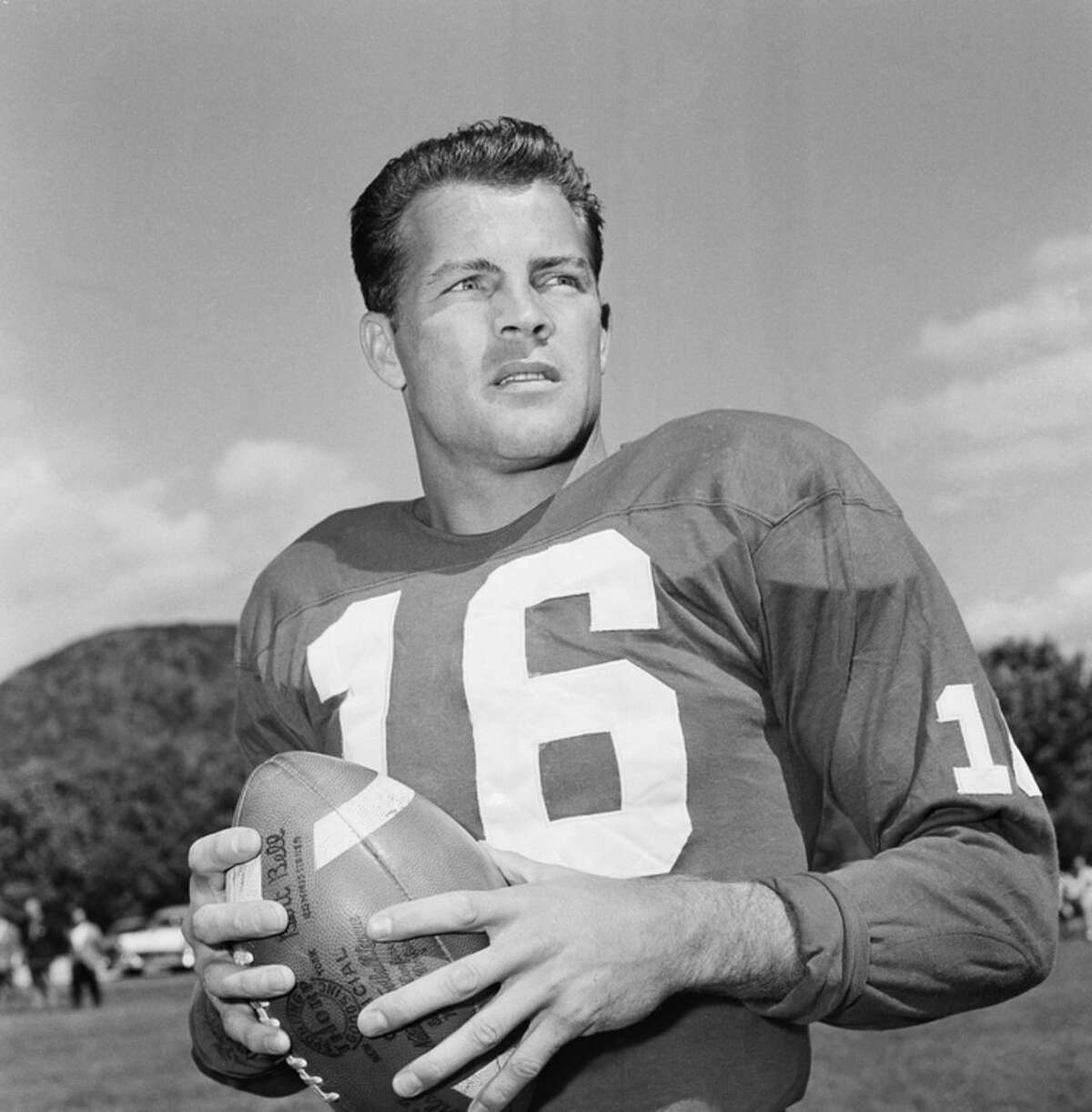 FILE - In this Sept. 9, 1958 file photo, New York Giants halfback Frank Gifford participates in a workout in New York. In a statement released by NBC News on Sunday, Aug. 9, 2015, his family said Gifford died suddenly at his Connecticut home of natural causes that morning. (AP Photo/John Rooney, File)