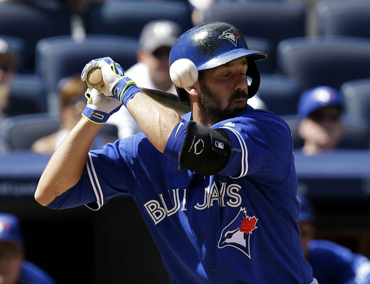 Toronto Blue Jays' Chris Colabello is hit by a pitch thrown by New York Yankees pitcher Adam Warren during the seventh inning of the baseball game at Yankee Stadium, Sunday, Aug. 9, 2015, in New York. (AP Photo/Seth Wenig)