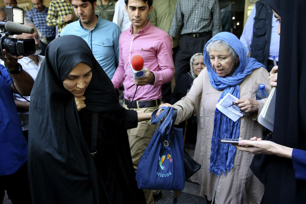 Mary Rezaian, mother of detained Washington Post correspondent Jason Rezaian, right, and Jason's wife Yeganeh leave a Revolutionary Court building in Tehran, Iran, Monday, Aug. 10, 2015. The final hearing of Rezaian detained in Iran more than a year ago and charged with espionage ended on Monday with a verdict expected in the coming days in a trial that has been condemned by the newspaper and press freedom groups. (AP Photo/Vahid Salemi)