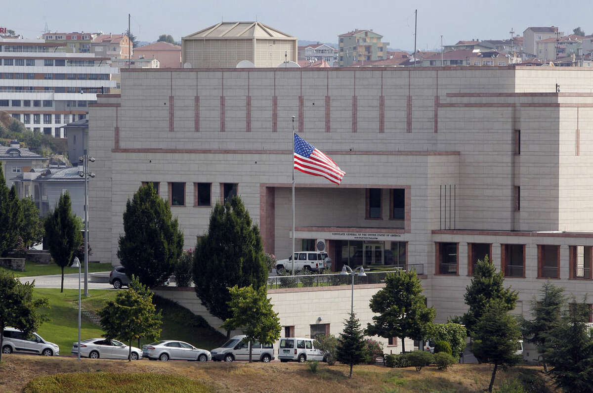 A U.S. flag flies in front of the U.S. Consulate building in Istanbul, Monday, Aug. 10, 2015. Two assailants opened fire at the building in Istanbul on Monday, touching off a gunfight with police before fleeing the scene, Turkish media reports said. (AP Photo/Lefteris Pitarakis)