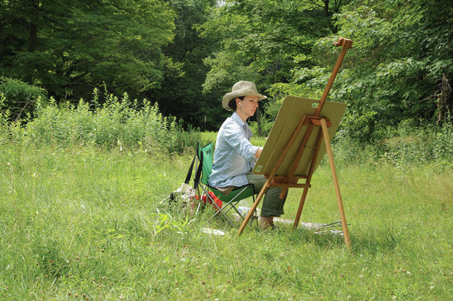 Michelle Schaffer doing watercolor painting Sunday at Weir Farm in Wilton as part of a workshop led by artist Dimitri Wright.