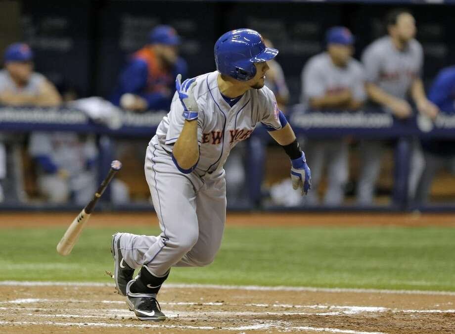 New York Mets' Michael Conforto hits an RBI-double off Tampa Bay Rays relief pitcher Brad Boxberger during the ninth inning of an interleague baseball game Friday, Aug. 7, 2015, in St. Petersburg, Fla. Mets' Lucas Duda scored on the hit. (AP Photo/Chris O'Meara)