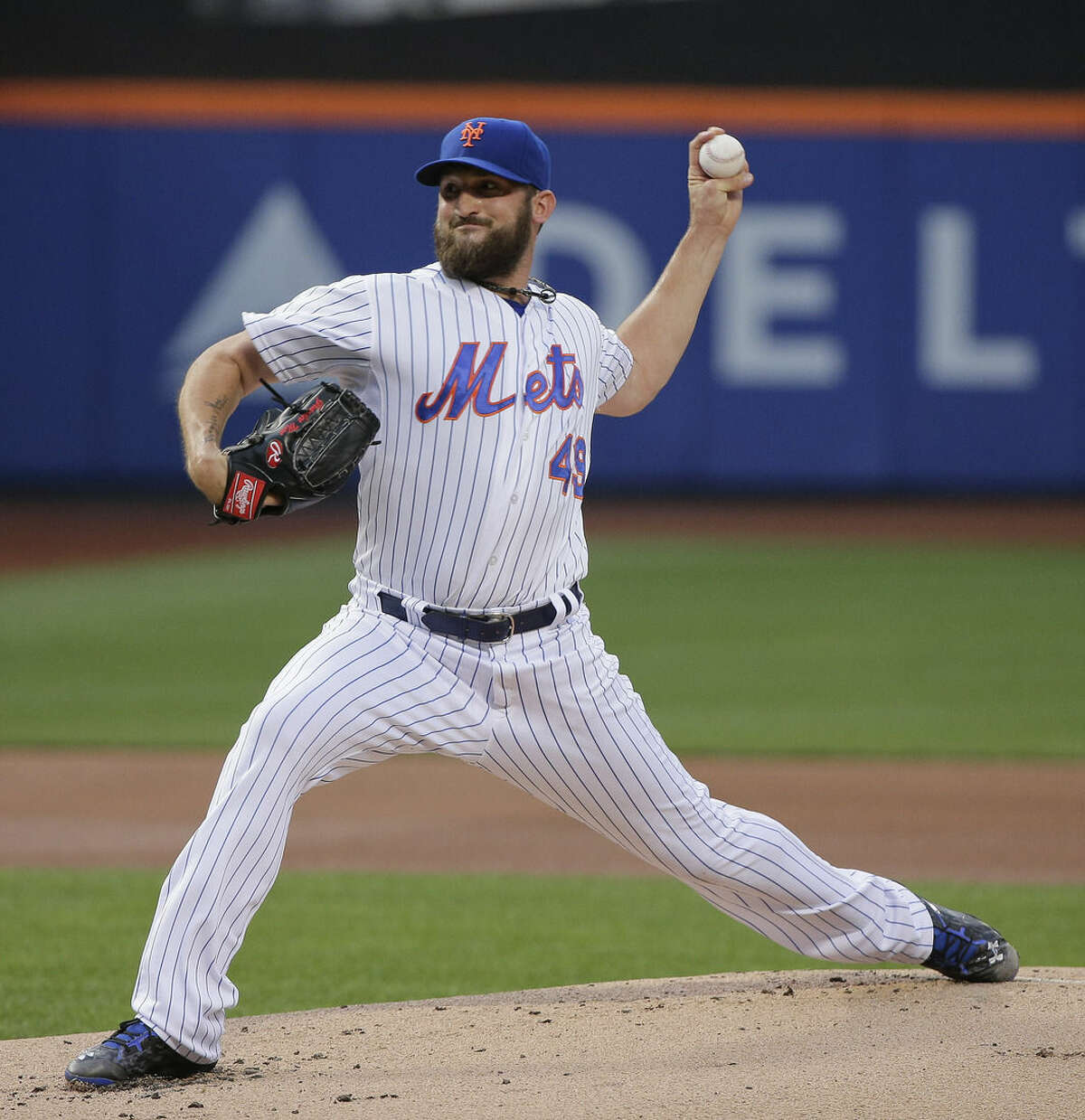 New York Mets pitcher Jonathon Niese delivers against the Colorado Rockies during the first inning of a baseball game, Monday, Aug. 10, 2015, in New York. (AP Photo/Julie Jacobson)