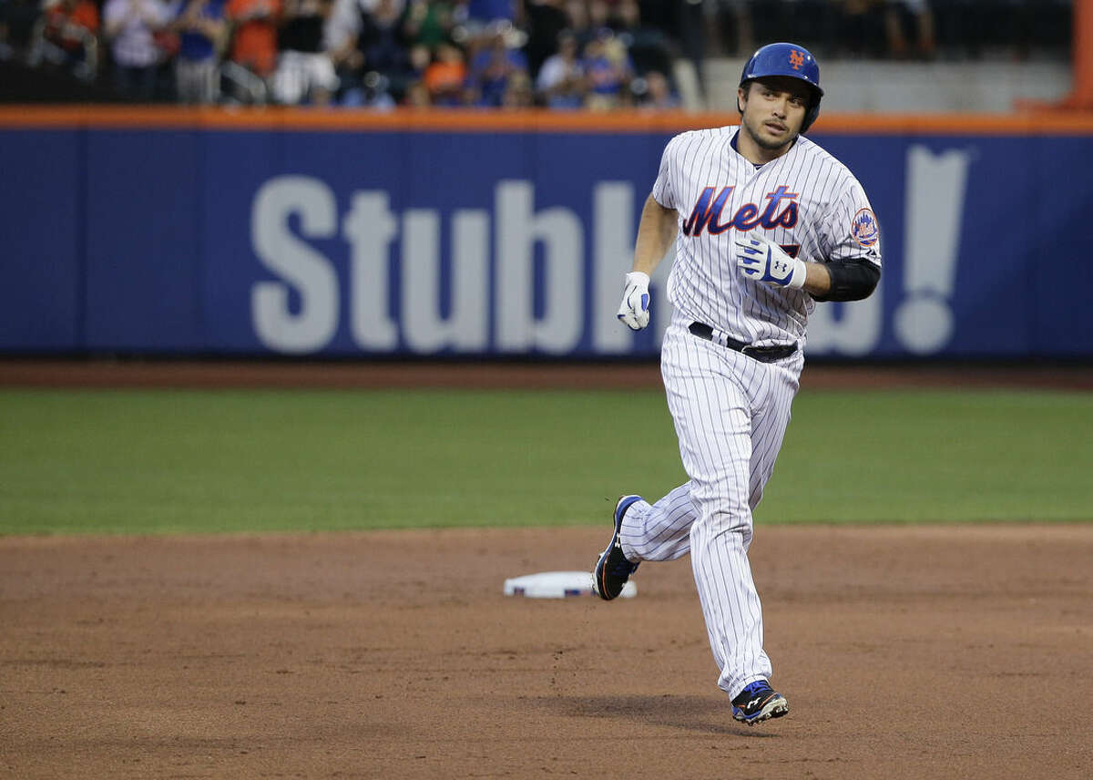 New York Mets' Travis d'Arnaud rounds the bases after hitting a solo home run against the Colorado Rockies during the second inning of a baseball game, Monday, Aug. 10, 2015, in New York. (AP Photo/Julie Jacobson)