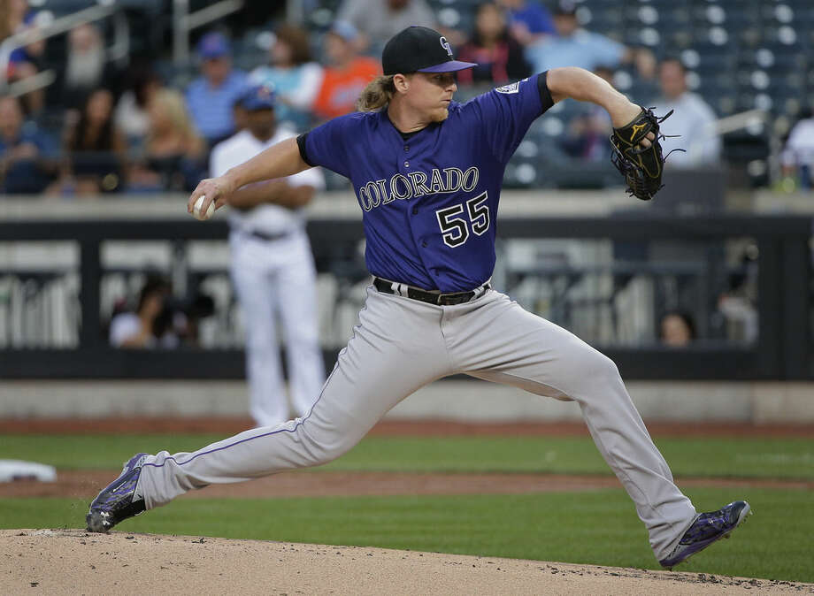 Colorado Rockies pitcher Jon Gray delivers against the New York Mets during the first inning of a baseball game, Monday, Aug. 10, 2015, in New York. (AP Photo/Julie Jacobson)