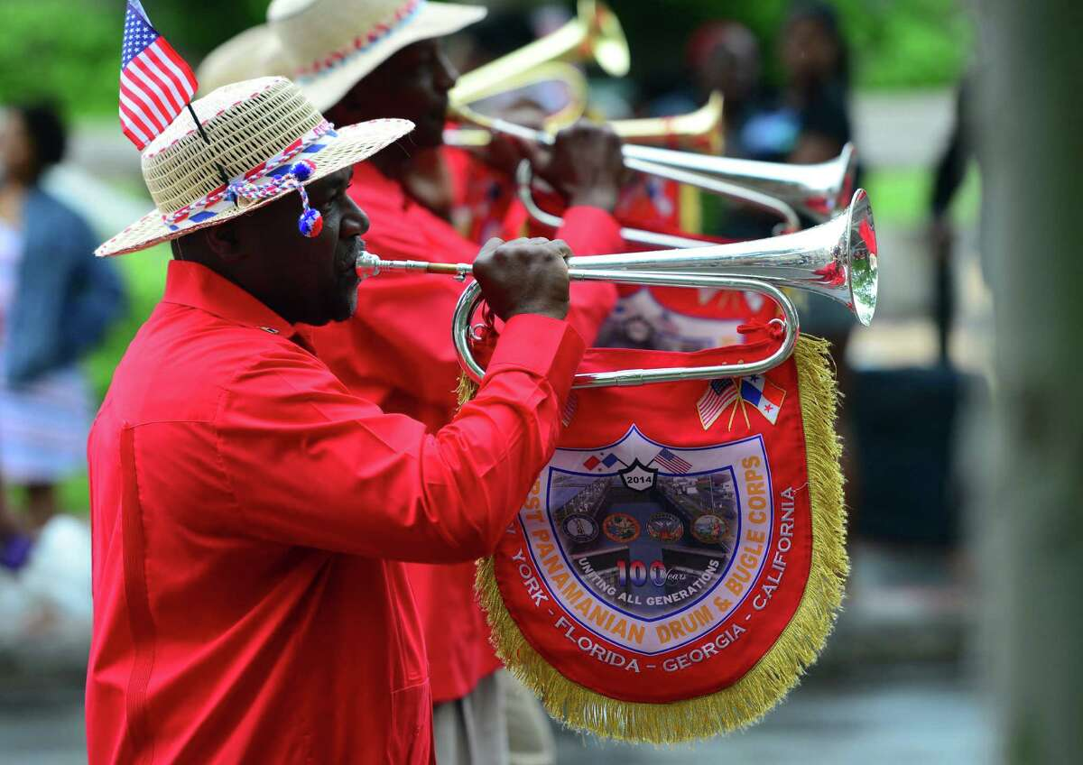 The First Panamanian Drum and Bugle Corps perform during the annual Juneteenth African-American Caribean Parade and Festival along in the parade route in downtown Bridgeport, Conn. on Saturday June 11, 2016. Despite a rain shower just after starting, hundreds of residents lined the route to watch local bands, organizations and even groups from New York City and Boston perform. Juneteenth is a uniquely American celebration commemorating the ending of slavery in the United States.