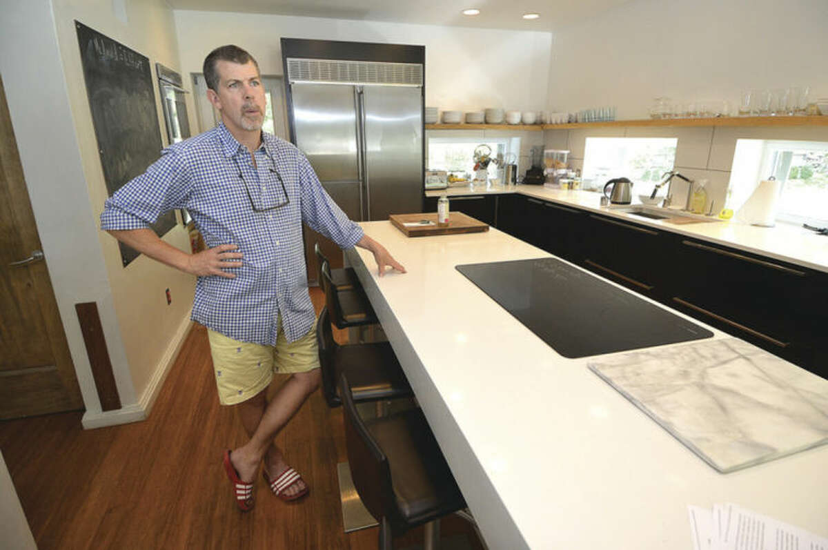 Hour photo/Alex von Kleydorff Doug Mcdonald stands in the kitchen of his Westport home, designed and buit with High Performace materials to be Pure. His new project in Westport will be a traditional New England designed Pure House