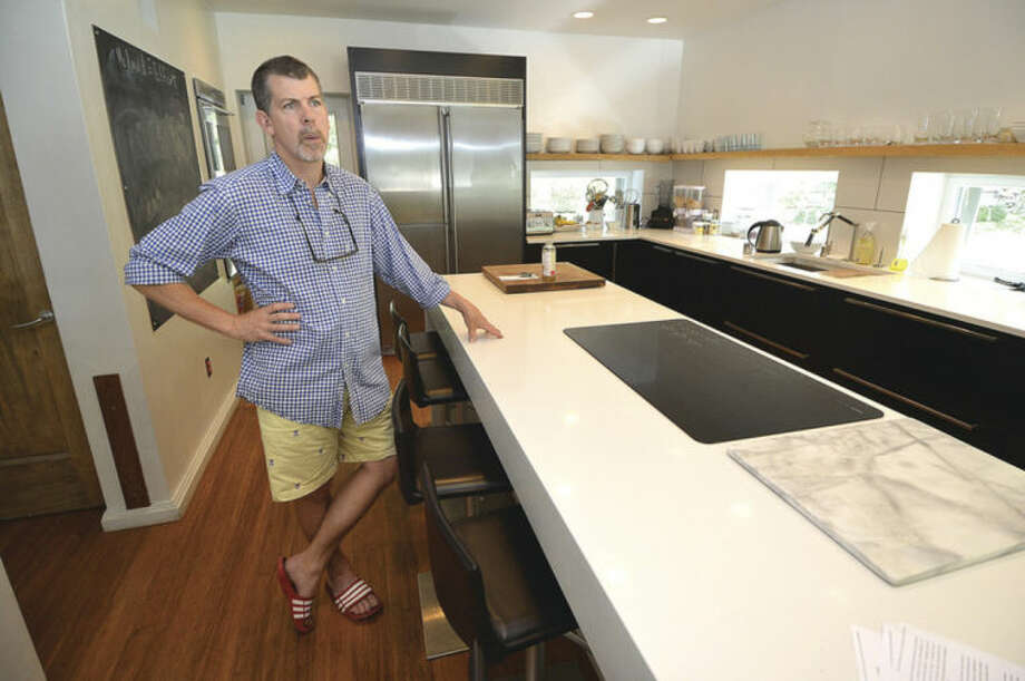 Hour photo/Alex von KleydorffDoug Mcdonald stands in the kitchen of his Westport home, designed and buit with High Performace materials to be Pure. His new project in Westport will be a traditional New England designed Pure House