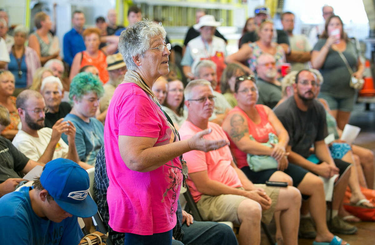 Resident Paula Collins asks for information from fire officials about the wildfire near Needles, Calif., Monday, Aug. 10, 2015. Wildfire crews battling a rapidly growing fire on the Arizona-California border near the Colorado River have called in help from California, Oregon and Washington states. (Michael Schennum/The Arizona Republic via AP)