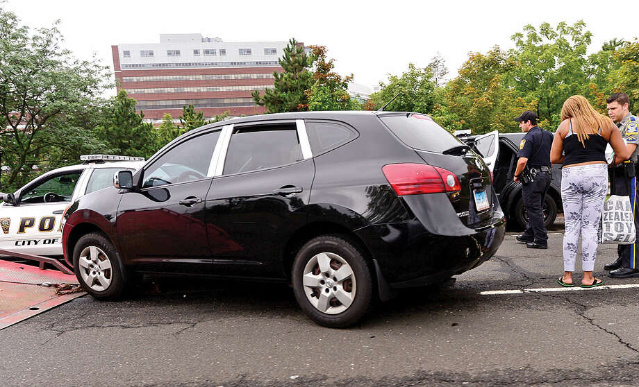 Hour photo / Erik Trautmann A Nissan Rogue collided with a Norwalk police cruiser Tuesday afternoon on Route 7 Southbound shortly after exit 1.