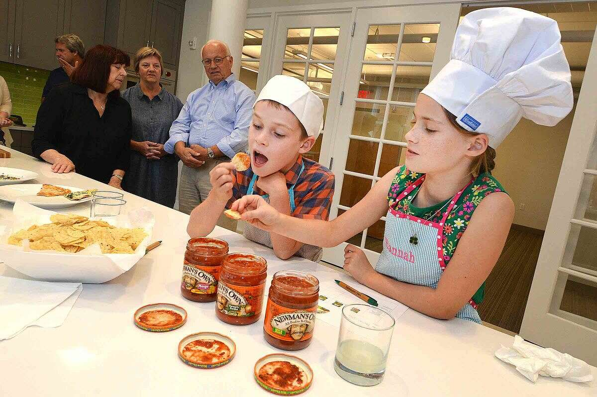Hour Photo/Alex von Kleydorff 10yr old Hannah Betts samples some of the different Salsa's at Newman's Own in Westport, as the Connecticut winner of 'The Healthy Lunchtime Challenge' she was honored with other winners at The White House Kids