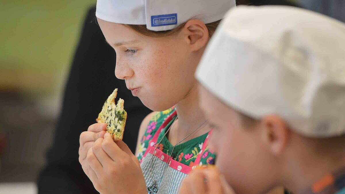 Hour Photo/Alex von Kleydorff 10yr old Hannah Betts tries one of the Thin and Crispy White Pie Pizzas at Newman's Own in Westport, as the Connecticut winner of 'The Healthy Lunchtime Challenge' she was honored with other winners at The White House Kids